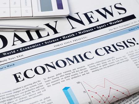 Photo pour Economic crisis headline on newspaper - image libre de droit