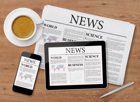 Photo for News page on tablet, mobile phone and newspaper - Royalty Free Image