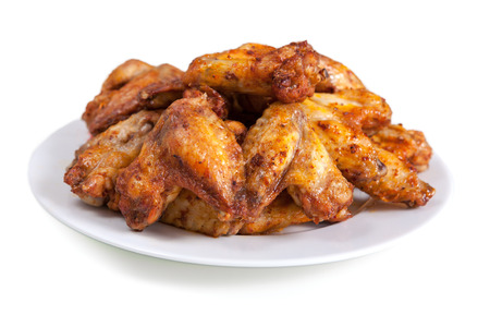 Photo for Plate of delicious barbecue chicken wings, on white - Royalty Free Image