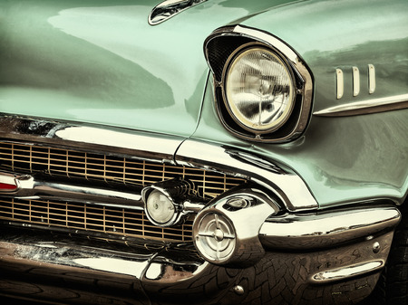 Retro styled image of a front of a green classic car mural