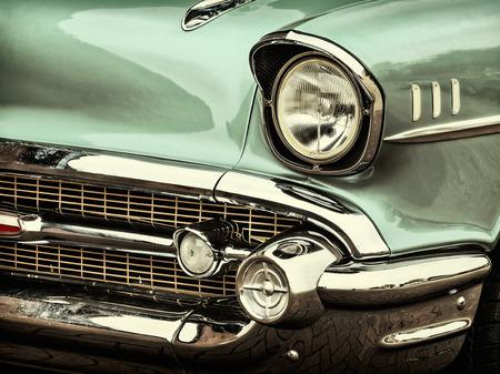 Photo pour Retro styled image of a front of a green classic car - image libre de droit