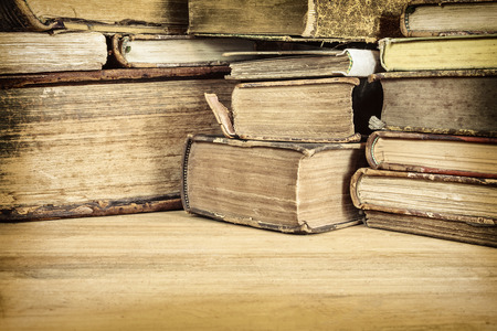 Photo for Sepia toned image of ancient books on a wooden table - Royalty Free Image