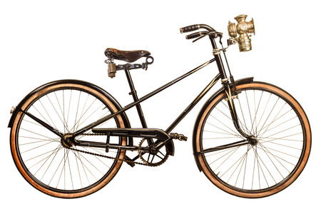 Foto de Retro styled image of a nineteenth century lady bicycle with lantern isolated on a white background - Imagen libre de derechos