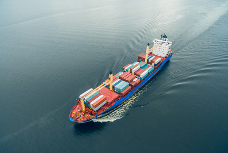 Foto per Aerial view of container vessel sailing in open sea - Immagine Royalty Free