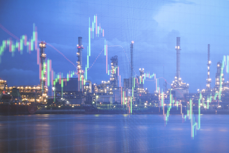 Photo pour Oil refinery with candlestick graph background , Business and financial concept - image libre de droit