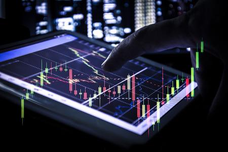 Photo pour candlestick graph on tablet , Business and financial concept - image libre de droit