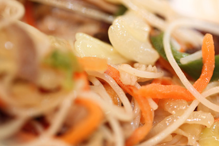 Rice vermicelli stir-fried with vegetables mix in pan.