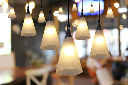 Foto de Warm lighting modern ceiling lamps in the cafe and interior decoration restaurant. - Imagen libre de derechos
