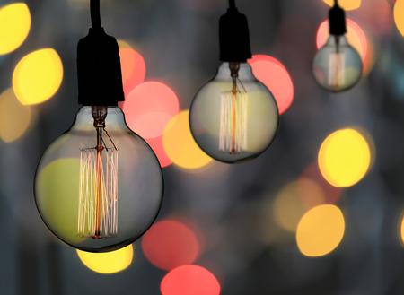 Foto de Vintage lamp or Modern Light bulb hang on ceiling in bokeh background,concept of interior and design in your work. - Imagen libre de derechos