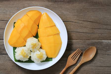 Photo for Mango and sticky rice in the white dish on wooden floor,Thai dessert popular in the summer of Thailand and have copy space. - Royalty Free Image