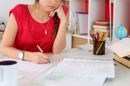 Photo for Female hand holding silver pen closeup. Woman writing letter, list, plan, making notes, doing homework. Student studying. Education, self development and perfection concept - Royalty Free Image