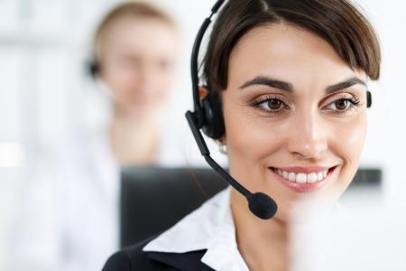 Foto de Female call center service operator at work.  - Imagen libre de derechos