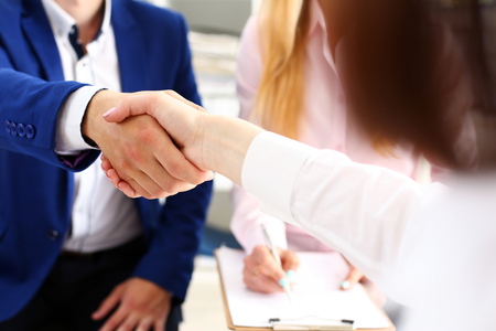 Photo pour Man in suit shake hand as hello in office closeup. Friend welcome, mediation offer, positive introduction, greet or thanks gesture, summit participate approval, motivation, strike arm bargain concept - image libre de droit