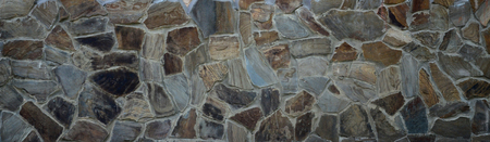 Foto de Rustic old beige brick worn foundation with shabby brown stones close up texture - Imagen libre de derechos