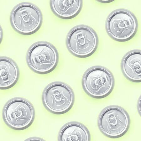 Foto de Many metallic beer cans on texture background of fashion pastel lime color paper in minimal concept. - Imagen libre de derechos
