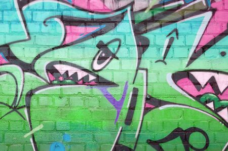 Photo for Abstract colorful fragment of graffiti paintings on old brick wall in pink and green colors. Street art composition with parts of unwritten letters and multicolored stains. Subcultural background - Royalty Free Image