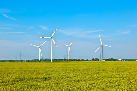 Photo for Wind energy wowers standing in the field in spring - Royalty Free Image