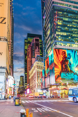 Foto für NEW YORK, USA - OCT  5, 2017:  neon advertising of News, brands and theaters at times square in early morning. Times square is a symbol for New York life and amusement. - Lizenzfreies Bild