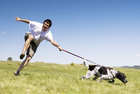 Man playing with his dog