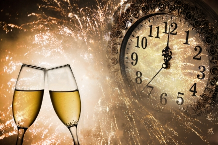 Foto de New Year s at midnight with champagne glasses and clock on light background - Imagen libre de derechos