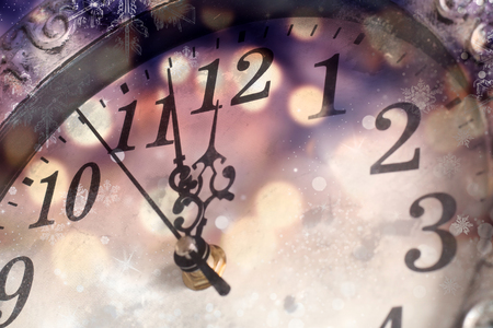Photo pour old clock with fireworks and holiday lights - New Year's at midnight - image libre de droit