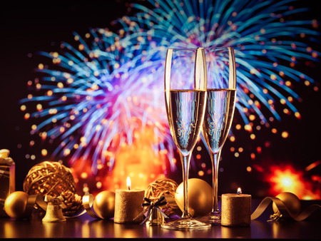 Photo pour two champagne glasses against holiday lights and fireworks - new year celebration - image libre de droit