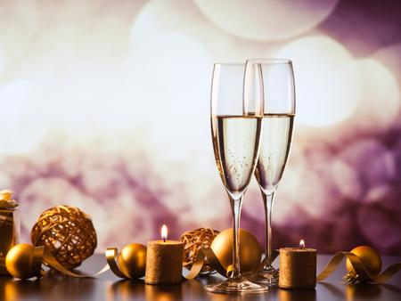 Foto de two champagne glasses against holiday lights and fireworks - new year celebration - Imagen libre de derechos