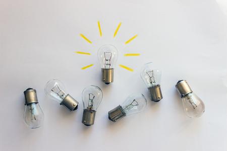 Photo pour Light bulb with rays  on a white background. Concept-  idea, innovation, business concept, creativity inspiration.  - image libre de droit