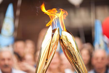 Foto de Sports relay. Sports torch relay. Sport symbol. Symbol of sports fulfillments. Fire transfer. - Imagen libre de derechos