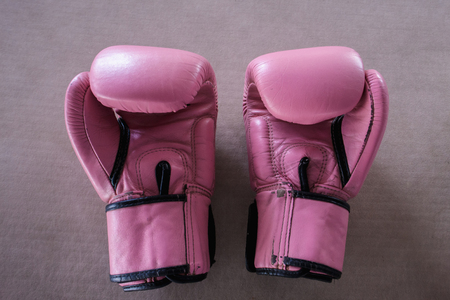 Photo for The pair of pink boxing gloves on pink background - Royalty Free Image
