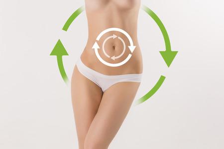 Foto de Women belly with the drawing arrows on it on white. Fat lose, liposuction and cellulite removal concept. - Imagen libre de derechos