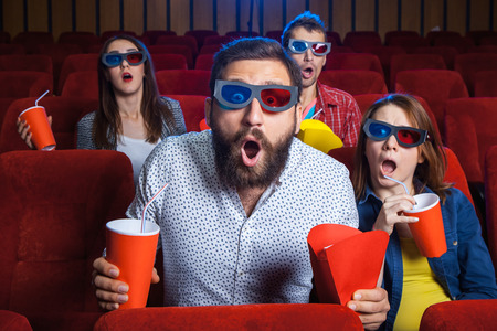Photo for A variety of human emotions of friends holding a cola and popcorn in the cinema. - Royalty Free Image