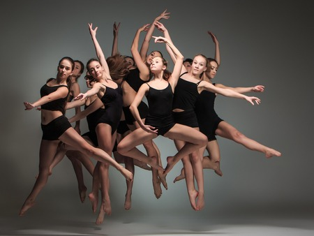 Photo pour The group of modern ballet dancers jumping on gray background - image libre de droit