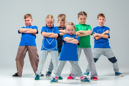 Photo pour The kids dance school, ballet, hiphop, street, funky and modern dancers on gray studio background - image libre de droit