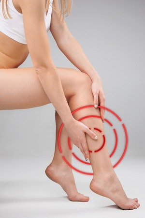 Foto de The female legs and hands on white background - Imagen libre de derechos