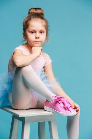 Photo for The little balerina dancer on blue background - Royalty Free Image