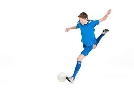 Photo pour Young boy with soccer ball doing flying kick - image libre de droit