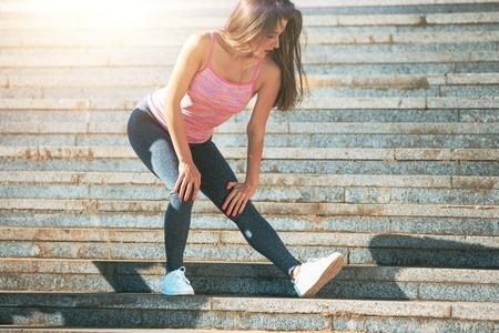 Photo pour Fit fitness woman doing stretching exercises outdoors at park - image libre de droit
