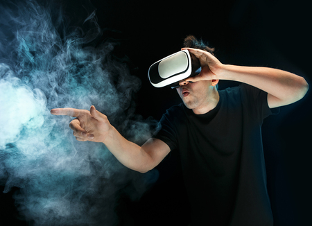 Photo for The man with glasses of virtual reality. Future technology concept. - Royalty Free Image