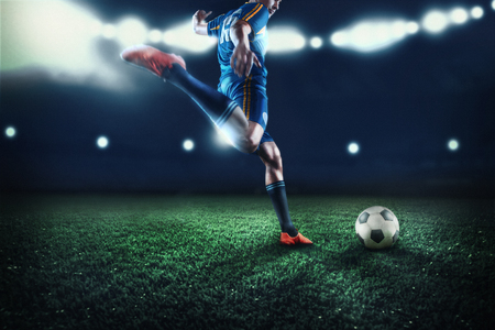 Foto de The active player of football at stadium in motion - Imagen libre de derechos