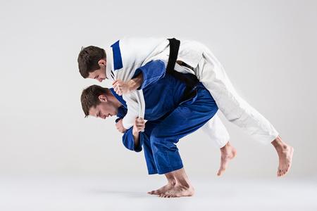 Foto de The two judokas fighters fighting men - Imagen libre de derechos
