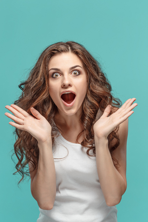 Photo for Portrait of young woman with shocked facial expression - Royalty Free Image