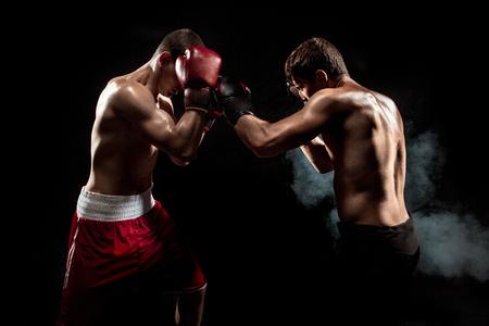 Foto für Two professional boxer boxing on black smoky background, - Lizenzfreies Bild
