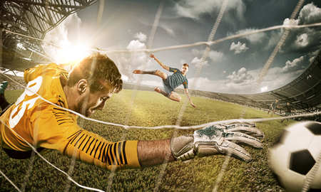 Photo for Goalkeeper in gates jumping to catching ball - Royalty Free Image