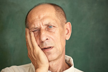 Photo for Worried mature man touching his head. - Royalty Free Image