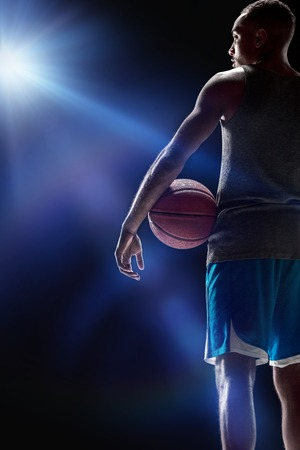 Foto de The portrait of a basketball player with ball - Imagen libre de derechos