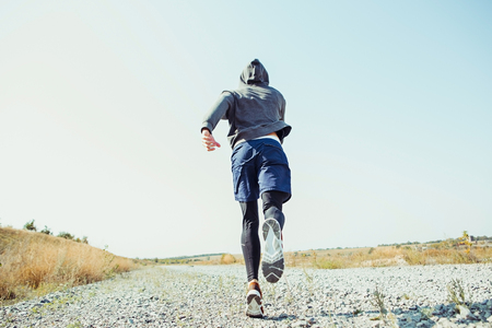Photo pour Running sport. Man runner sprinting outdoor in scenic nature. Fit muscular male athlete training trail running for marathon run. - image libre de droit