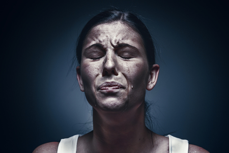 Photo for Close up portrait of a crying woman with bruised skin and black eyes - Royalty Free Image