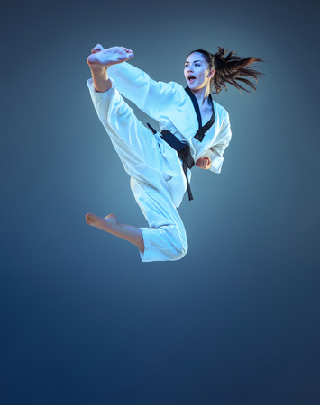 Foto de The karate girl with black belt - Imagen libre de derechos