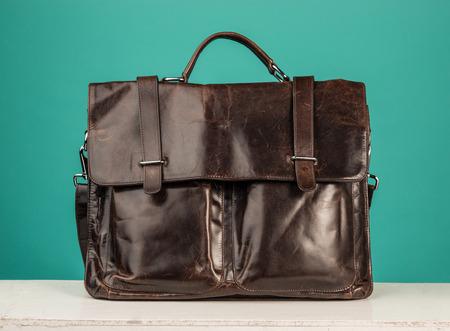 Foto de A vintage leather briefcase on a blue background - Imagen libre de derechos